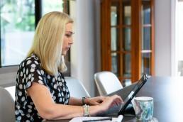 Jayne Arlett working on iPad